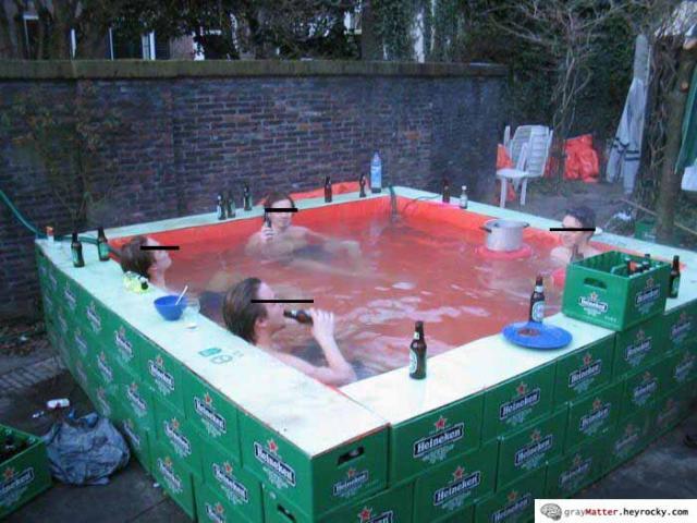 Redneck hot tub greymatter - Redneck swimming pool with hay bales ...